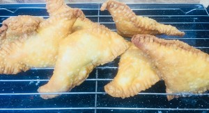 Curry Puffs in short crust pastry.