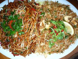 Mee goreng left and beehoon goreng (rice vermicelli) on the right.