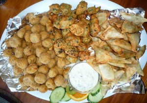 Samosa, rice ball and pakora catering platter.