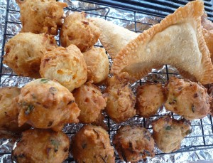 Onion and chives puffs pictured here with other street foods.